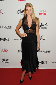 Jessica Hart sizzled on the red carpet in a sheer, deep-V lace blouse during the Fashion Media Awards.