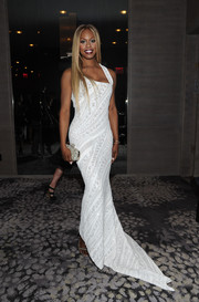 Laverne Cox complemented her gown with a bejeweled clutch.