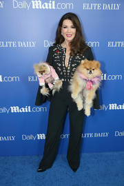 Lisa Vanderpump hit the DailyMail.com & Elite Daily holiday party wearing an embellished-bodice jumpsuit.