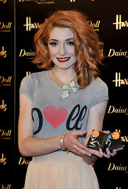 Nicola showed off her faux pearl necklace with Diamante Bow while promoting her new makeup line.