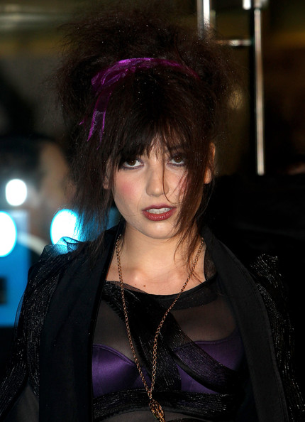Daisy Lowe Messy Updo [alice in wonderland,hair,hairstyle,purple,bangs,fashion,beauty,black hair,cool,goth subculture,hair coloring,arrivals,daisy lowe,england,london,odeon leicester square,royal world,premiere,alice in wonderland: royal world premiere]
