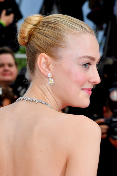 Dakota Fanning Classic Bun [hair,hairstyle,chignon,beauty,shoulder,chin,eyebrow,blond,bun,premiere,dakota fanning,once upon a time in hollywood,screening,cannes,france,red carpet,the 72nd annual cannes film festival,cannes film festival]