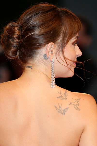 Dakota Johnson Classic Bun [suspiria,hair,neck,shoulder,hairstyle,face,back,chin,ear,skin,chignon,dakota johnson,sala grande,red carpet,venice,italy,suspiria red carpet arrivals,venice film festival,screening]