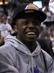 Lil Wayne showed off his grill and his chin piercings while at an NBA Finals game.