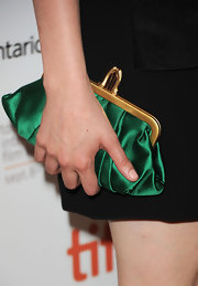 Greta Gerwig added a vintage feel to her look with an emerald-green frame clutch when she attended the 'Damsels in Distress' premiere.