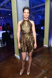 Cobie Smulders glammed it up in a metallic gold dress with a halter neck and a cutout at the neck.