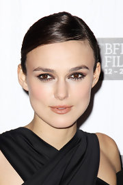 Keira Knightley wore a peachy-beige satin finish lipstick at the premiere of 'A Dangerous Method.' The color choice was the perfect complement to her dramatic eyes, hair and dress.