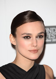 Keira Knightly wore her tresses in a sexy lacquered bun at the London premiere of 'A Dangerous Method.'