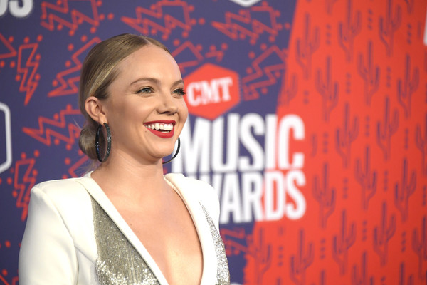 Danielle Bradbery Chignon [facial expression,red,smile,mouth,talent show,laugh,premiere,performance,singing,style,arrivals,danielle bradbery,cmt music awards,bridgestone arena,nashville,tennessee]