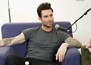 A simple gray t-shirt showed off Adam Levine's casual style as well as his many tattoos!