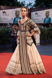 Alicia Vikander looked like she just stepped out of fairytale land in this Louis Vuitton embroidered princess gown during the Venice Film Fest premiere of 'The Danish Girls.'
