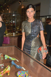 Giovanna Battaglia sported a mishmash of patterns with this mixed-print clutch and laser-cut dress combo at the 'Dans les Pas de Roger Vivier' exhibition.