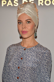 Ulyana Sergeenko dressed up her look with an ivory silk turban for the 'Dans les Pas de Roger Vivier' exhibition launch.