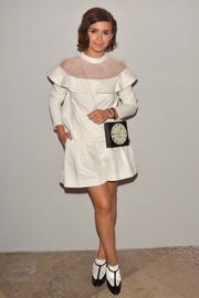 Miroslava Duma chose a fun-looking sheer-panel white blouse for the 'Dans les Pas de Roger Vivier' exhibition launch.