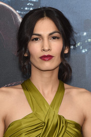 Elodie Yung's berry lipstick made a beautiful contrast to her chartreuse dress.