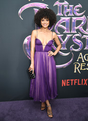 Nathalie Emmanuel looked downright fab in a pleated purple cocktail dress by Miu Miu at the New York premiere of 'The Dark Crystal: Age of Resistance.'