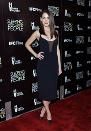 Alison Brie went for sultry appeal at the premiere of 'Sleeping with Other People' in a black Narciso Rodriguez slip dress with a cleavage-flaunting lace-accented bodice.