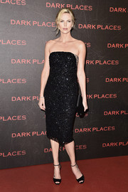 Charlize Theron oozed classic elegance in an embellished black strapless dress by Christian Dior Couture at the Paris premiere of 'Dark Places.'