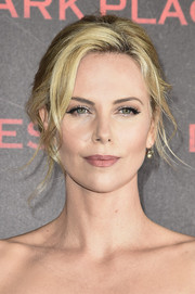 Charlize Theron looked absolutely stunning wearing this loose chignon at the Paris premiere of 'Dark Places.'