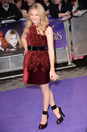Chloe Grace Moretz paired her gorgeous burgundy frock with edgy black and oxblood pumps featuring bold ankle straps.