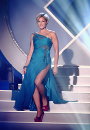 Helene Fischer looked captivating in a teal one-shoulder dress with a thigh-high slit during the 'Das Herbstfest Der Abenteuer' show.