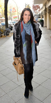 Christine Neubauer accented her layered winter style with a tan leather tote.