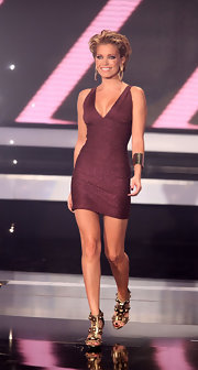 Sylvie van der Vaart looked posh in a burgundy Herve Leger glitter bandage dress as she hosted 'Das Supertalent'.