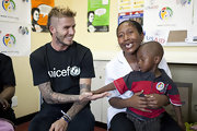 Beckham promotes Unicef with this black tee.