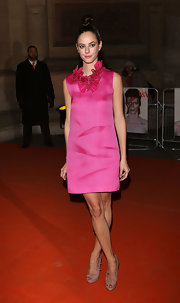 Kaya Scodelario sported a fuchsia cocktail dress with a ruffled collar for her red carpet look.