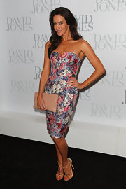 Megan Gale completed her girly outfit with a pair of nude T-strap sandals.