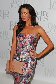 Megan Gale added a hint of edginess to her feminine dress with a spiked nude clutch when she attended the David Jones collection launch.