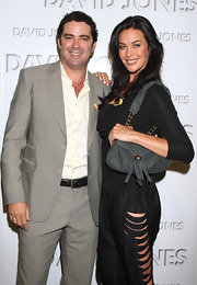 Megan Gale broke her all-black palette with a tasseled gray snakeskin bag when she attended the David Jones autumn/winter season launch.