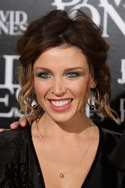 Dannii Minogue rocked two-tone curls, which she delicately pinned back in the front.