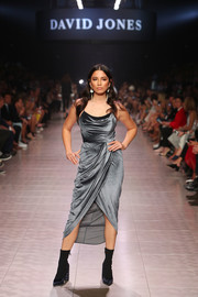 Jessica Gomes struck a pose on the David Jones runway wearing a draped gray cocktail dress.