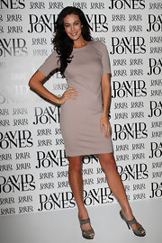 Megan Gale's stylish gray platform sandals added some flair to her simple look.