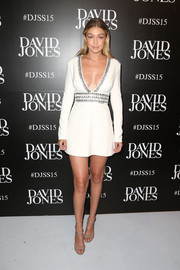 Gigi Hadid attended the David Jones Spring 2015 fashion launch flaunting an eyeful of skin in a deep-V LWD with a studded neckline and mid-section.