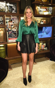 Katrina Bowden went for boho elegance in an emerald silk blouse with blouson sleeves during the David Yurman Soho boutique grand opening.
