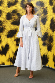 Gemma Arterton cut a feminine silhouette in a striped dress with fluted sleeves and a cinched-in waist at the Locarno Film Fest photocall for 'The Girl with All the Gifts.'