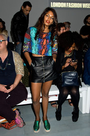 M.I.A. polished off her multi-hued ensemble with a pair of metallic green loafers.