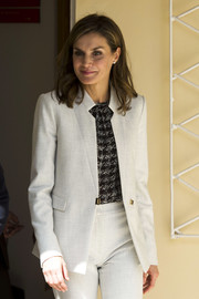 Queen Letizia of Spain suited up in a white Hugo Boss jacket and trouser set for her visit to the Cervantes Institute in Senegal.