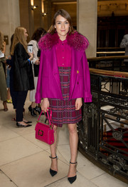 Ella Catliff looked darling in her Matthew Williamson ensemble, consisting of a fur-collar pea-coat and a dress in various shades of purple, pink, and red, during the label's fashion show.