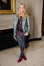 Mary Charteris was punk-glam at the Matthew Williamson fashion show in a metallic silver leather jacket.