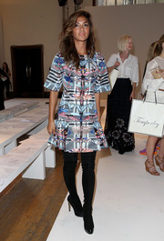 Nicole Scherzinger looked funky in a dragonfly-print dress by Temperley London during the brand's fashion show.