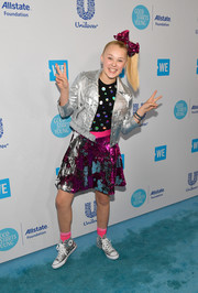 JoJo Siwa sealed off her sparkling ensemble with silver Chuck Taylors.