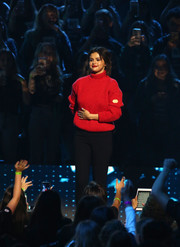 Selena Gomez spoke onstage at WE Day California wearing a classic red turtleneck.