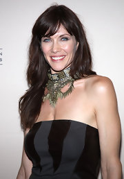 Stacey paired her black strapless dress with a gold collar necklace full of spikes and studs.