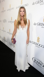 Nina Agdal wore a dangerously low-cut white Gyunel gown at the De Grisogono party in Cannes.