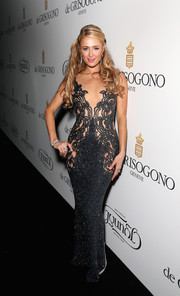 Paris Hilton opted for a curve-hugging, skin-revealing beaded gown for her De Grisogono party look.