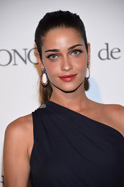 Ana Beatriz Barros complemented her ponytail with a pair of multicolored dangling decorative earrings when she attended the de Grisogono party in Cannes.