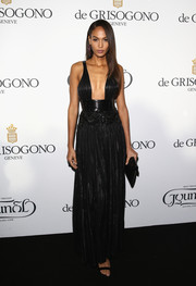 Joan Smalls displayed major cleavage in a plunging black Givenchy Couture gown during the De Grisogono party in Cannes.
